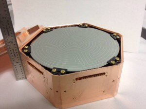 Photograph of one of the SuperCDMS Germanium detectors. Credit: SLAC